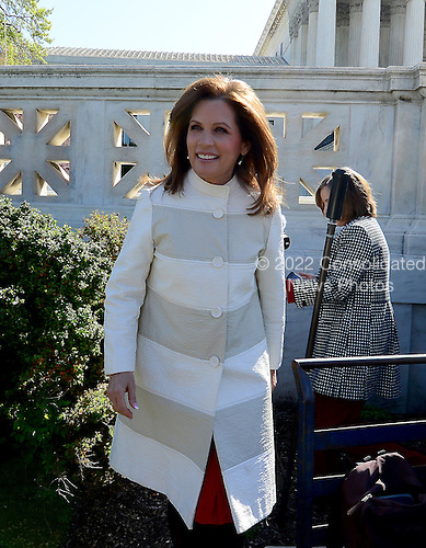 United States Representative Michele Bachmann (Republican of Minnesota) departs after makings remarks to demonstrators outside the U.S. Supreme Court Building as oral arguments concerning the Constitutionality of the U.S. Health Care Law continue inside the building.  .Credit: Ron Sachs / CNP