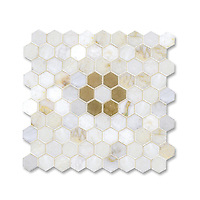 Flower Hex shown in polished Cloud Nine and Honey Onyx is part of New Ravenna's Studio Line. All mosaics in this collection are ready to ship within 48 hours.<br />