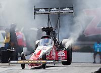 Sep 18, 2016; Concord, NC, USA; NHRA top fuel driver Doug Kalitta does a burnout during the Carolina Nationals at zMax Dragway. Mandatory Credit: Mark J. Rebilas-USA TODAY Sports
