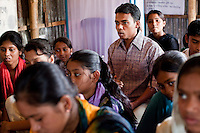 "Jewel Mahammud Kawsan (17, center right) speaks during a monthly meeting of a Children's Group in Bhashantek Basti (Slum) in Zon H, Dhaka, Bangladesh on 23rd September 2011. When asked if an abused wife could return to her family, Jewel says, ""Society doesn't take it well. It is not accepted if she leaves the husband's house. Even (her own parents) will tell her to be accommodative even if her husband beats her, because after marriage, that is now her real address."" Jewel also tells a true story of a girl who used to be a member of the children's group. When she turned 14/15, her parents wanted to marry her off. The children's group went to village elders to counsel the family and the marriage was stopped. The children felt proud but sadly, after 2 months, she was quietly married off. Now, at 18, she is a mother of a girl child and is not happy in the marriage. Her husband is also a young boy but is violent in nature and beats her. She is tied to motherhood and house chores and not allowed to join the other children. The families are also fighting because of dowry related issues."" The Bhashantek Basti Childrens Group is run by children for children with the facilitation of PLAN Bangladesh and other partner NGOs. Slum children from ages 8 to 17 run the group within their own communities to protect vulnerable children from child related issues such as child marriage. Photo by Suzanne Lee for The Guardian"