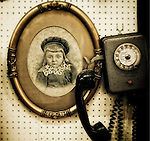 Antique phone and vintage framed photograph of young child