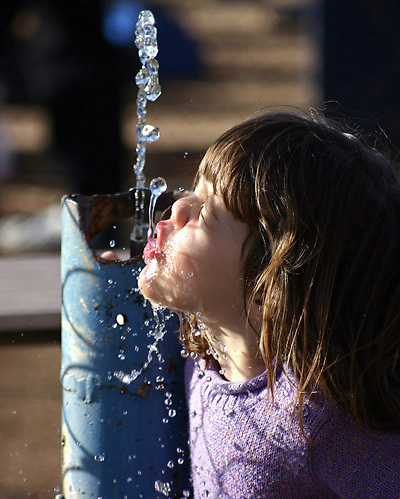 Kaitlyn Bowles, 4 yrs old, enjoys a cool drink during a Benicia High baseball game.  Kaitlyn's dad is the Panther's coach, Jim Bowles.