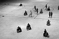 Colombian disabled athletes leave the playground after a wheelchair rugby training match at the indoor sporting arena Coliseo in Bogota, Colombia, 11 April 2013. Wheelchair rugby, a full-contact team sport, was developed in Canada in 1977 under the name murderball. The game is played only by athletes with some form of disability in both the upper and lower limbs (quadriplegics). Attempting to score by carrying the ball across the goal line, four players from each team roughly crash into each other in specially designed armored wheelchairs. Although the team from Bogota is supported by a foundation (gear), quad rugby players, mostly coming from the remote, socially deprived neighbourhoods, often can not attend a training due to lack of funds for transportation. However, they still dream of representing Colombia at Rio 2016 Paralympic Games.