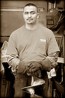 Construction worker with auger.