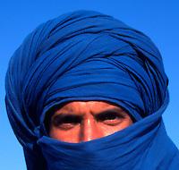 Portrait of a Tunisian Berber Tribesman Camel Rider at the Douz Sahara Desert Festival. Tunisia