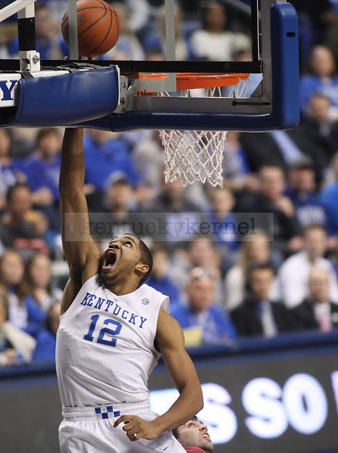 UK forward Karl-Anthony (12) lays up the ball during the first half of the University of Kentucky men's basketball game vs. Eastern Kentucky University at Rupp Arena in Lexington, Ky., on Sunday, December 7, 2014. UK led 41 - 14 at the half. Photo by Tessa Lighty   Staff