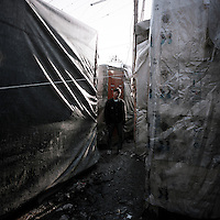 16 year old Afghan Hababullah is living in a refugee shanty town in Patras. Patras is home to about 3,000 illegal immigrants. Most of them are Afghans, although there are also some Iranians and Uzbeks. They stop in Patras to try and find passage to various European destinations by hiding in ships, containers and trucks parked in the port. If they are lucky they will make it to their destination. Many of them live in shacks made from cartons, plastic and wood they found on the beach. To shelter from the cold they also squat in abandoned buildings, living without water and electricity. The living conditions are inhumane and unhygienic.