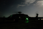 "A Medevac helicopter from the 101st Aviation Regiment refuels after a rescue mission at night in Paktika province, Afghanistan, 21 July, 2008. Also known by their call sign ""Dust Off"","" the Medevac pilots, crew and medics are ready to fly at a moments notice, picking up Coalition soldiers as well as Afghans that require help.(John D McHugh)"