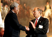 Washington, DC - September 23, 1998 -- President Nelson Mandela of South Africa and United States Senator Alfonso D'Amato (Republican of New York) shake hands following the latter's speech accepting the Congressional Gold Medal in the United States Capitol Rotunda on Wednesday, September 23, 1998...Credit: Ron Sachs / CNP