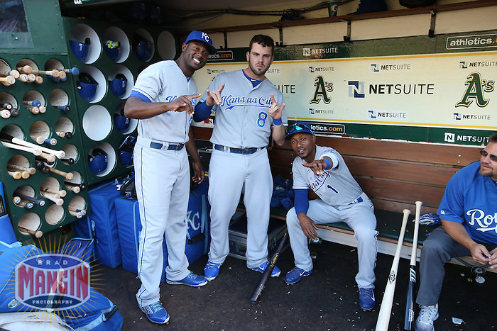 OAKLAND, CA - AUGUST 1:  Lorenzo Cain #6, Mike Moustakas #8, and Jarrod Dyson #1 of the Kansas City Royals pose for a picture in the dugout before the game against the Oakland Athletics at O.co Coliseum on Friday, August 1, 2014 in Oakland, California. Photo by Brad Mangin