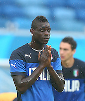 Mario Balotelli of Italy gestures to pray during training ahead of tomorrow's Group D match vs Uruguay