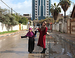 """Sawsan Al Khalili, 40 years-old, a Palestinian woman of special needs poses for a photo at street in Gaza city on Feb. 11, 2017. Al Khalili secretary general of the general union of the Palestinian disabled and a head of the Palestinian farsat club for women with disabilities and she has a degree in law and information technology. """"I defend the rights of the disabled and became their ambassador in six European countries"""" Al Khalili said. Photo by Samar Eliwa"""