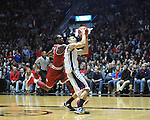 "Ole Miss' Marshall Henderson (22) vs. Arkansas' Mardracus Wade (1) at the C.M. ""Tad"" Smith Coliseum in Oxford, Miss. on Saturday, January 19, 2013. Mississippi won 76-64. (AP Photo/Oxford Eagle, Bruce Newman)"