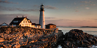 The Portland Head Light bathed in the sunlight of a new day.   The lighthouse is located in Fort Williams Park, Cape Elizabeth, Maine.