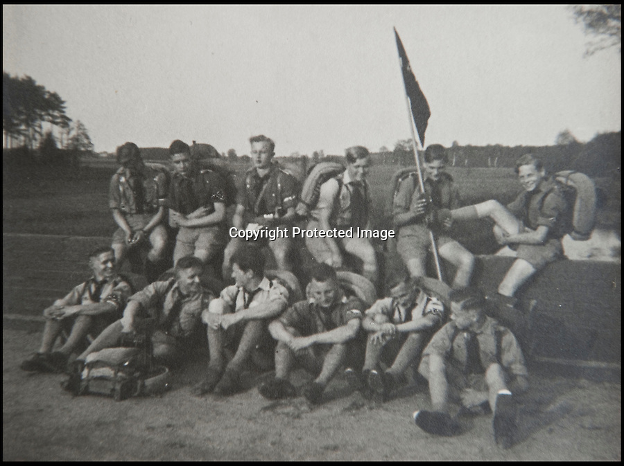 BNPS.co.uk (01202 558833)<br /> Pic: Mullocks/BNPS<br /> <br /> ***Please Use Full Byline***<br /> <br /> Helmut Nieboy's 'KamaradSchaft Florian Geyer' Hitler Youth company.<br /> <br /> Sinister archive illustrating the Nazi brainwashing of German youth comes to light...<br /> <br /> A chilling archive of an enthusiastic member of the Hitler Youth has emerged to highlight how the Nazi's brainwashed German children in the build up to WW2<br /> <br /> Helmut Nieboy kept detailed diaries during his time with the German equivalent of the Boy Scouts from 1933.<br /> <br /> Helmut also amassed a number of photographs of his time with the paramilitary group, showing the youngsters sitting around a campfire, marching and at rallies. <br /> <br /> The diaries also include incredibly detailed route marches as well as hand drawn portraits of the beloved Fuhrer with patriotic slogans.<br /> <br /> The archive, that also includes his Hitler Youth tent, knife and trumpet, are being sold by Mullock's Auctioneers of Shropshire.