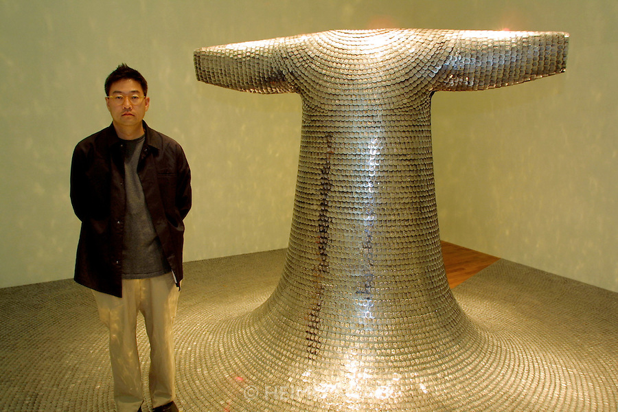"""VENICE, ITALY..49th Biennale of Venice.Korean Pavillion..Do-Ho Suh with his sculpture """"Some/One"""", 2001..(Photo by Heimo Aga)"""