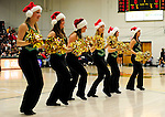 13 December 2009: The UVM Dance Team entertain the fans at a game between the University of Vermont Catamounts and the Quinnipiac University Bobcats at Patrick Gymnasium in Burlington, Vermont. The Catamounts defeated the visiting Bobcats 80-77 to mark the Cats' season home opener with a win. Mandatory Credit: Ed Wolfstein Photo