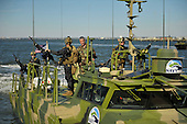 Rear Admiral Michael P. Tillotson, commander of Navy Expeditionary Command, thanks Sailors assigned to Riverine Group 1 for the ride Friday, October 22, 2010 on Riverine Command Boat (Experimental) (RCB-X) at Naval Station Norfolk. The RCB-X is powered by an alternative fuel blend of 50 percent algae-based and 50 percent NATO F-76 fuels to support the Secretary of the Navy's efforts to reduce total energy consumption on naval ships. .Mandatory Credit: Gregory N. Juday - U.S. Navy via CNP
