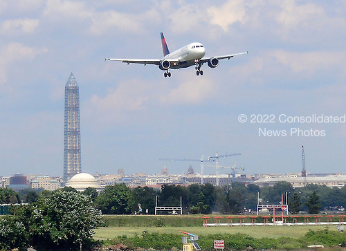 An Airbus A-319 aircraft operated by Delta Airlines on final approach to Ronald Reagan Washington National Airport in Arlington, Virginia on August 21, 2013.  Photo was taken from the window of an aircraft waiting on the tarmac for its turn to take-off on Reagan National's single main runway. <br /> Credit: Ron Sachs / CNP