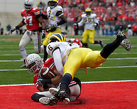 November 22, 2008. Ohio State wide receiver Brian Robiskie (80) makes an 8-yard touchdown reception despite the efforts of Michigan cornerback Donovan Warren. The Ohio State Buckeyes defeated the Michigan Wolverines 42-7 on November 22, 2008 at Ohio Stadium, Columbus, Ohio.