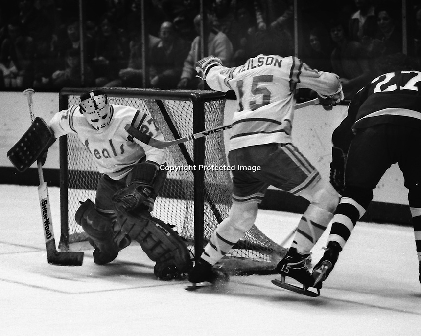 Seals goalie Gilles Meloche and Jim Neilson battle Toronto Maple Leafs Dave &quot;Tiger&quot; Williams..<br />