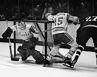 Seals goalie Gilles Meloche and Jim Neilson battle Toronto Maple Leafs Dave &quot;Tiger&quot; Williams..<br />(1975 photo/Ron Riesterer)