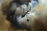 Helicopter around the area where a fire burns,in Cualedro, near Ourense, on August 10, 2010 (c) Pedro ARMESTRE
