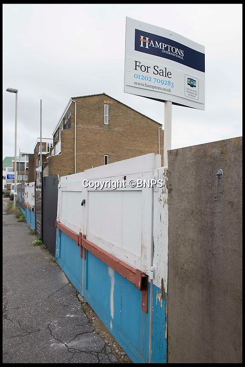 BNPS.co.uk (01202 558833)<br /> Pic: LauraDale/BNPS<br /> <br /> Boarded up: The front of the plot, on Banks road, displaying a Hampton's 'For Sale' sign.<br /> <br /> A narrow empty plot of land in the world-renowned Sandbanks area is on the market for &pound;6.25million.<br /> <br /> The piece of land is worth &pound;2m more now its empty than it was when the owner bought it with two semi-detached houses on it.<br /> <br /> The area in Dorset, often called Millionaire's Row, is said to be the fourth most expensive place in the world to live and this plot is one of the few left to redevelop.