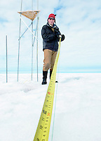 Scientist measuring how much the Greenland ice sheet has melted and moved since the previous field season. Using Global Positioning System measurements, the glaciologist learned that the area he studies on the western flanks of Greenland slides a hundred yards closer to the coast each year.