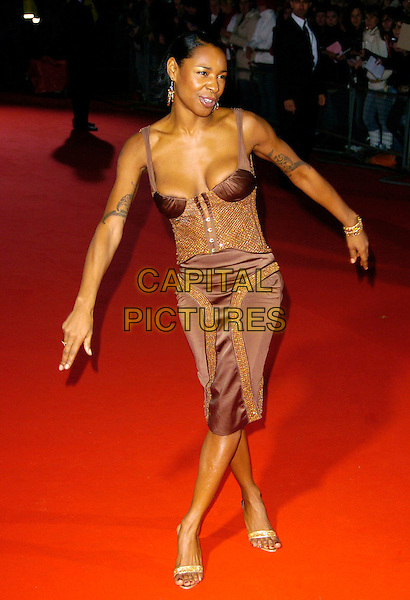 SONIQUE.Arrivals at World Music Awards 2006, Earls Court, London, UK..November 15th, 2006.full length brown sparkly dress tattoos arms.CAP/CAN.©Can Nguyen/Capital Pictures