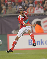 SL Benfica forward Weldon (19) crosses the ball. SL Benfica  defeated New England Revolution, 4-0, at Gillette Stadium on May 19, 2010.