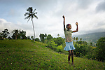 """Romage Jean Louis, a member of Nouvel Etwal - Haitian Kreyol for """"New Stars"""" - dances on a hillside in Mizak, Haiti. Nouvel Etwal is a dance and creative movement group of 16 girls from age 8 to 13, based in the southern village of Mizak. According to Valerie Mossman-Celestin, an organizer of the group, """"Nouvel Etwal seeks to empowers girls to be self-confident and creative. The girls learn flexibility, discipline and teamwork, lessons they also need for life. Nouvel Etwal promotes health, well-being and enhanced self-worth. The girls are encouraged to live into a brighter future where girls and women are valued,  educated, and have equal opportunity to achieve their potential."""""""