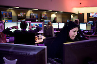 Journalists at work in the newsroom at news channel Al Jazeera English in Doha.