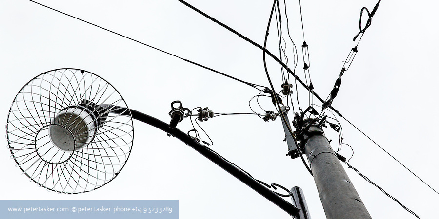 Japanese power pole, light fitting and cables.