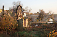 The Molino de la Albolafia, a noria or Islamic water wheel on the Guadalquivir river, Cordoba, Andalusia, Southern Spain. The water wheel was added to a Roman mill at the time of Abd-al-Rahman II in the 9th century, to raise the river water to the Caliphal Palace, later converted to the Episcopal Palace by the Catholic Kings. Behind is the Roman bridge, built in the 1st century BC over the Guadalquivir river. The historic centre of Cordoba is listed as a UNESCO World Heritage Site. Picture by Manuel Cohen