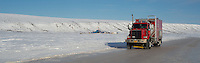 A Cruz Construction mechanics' truck leaves an exploration rig in Umiat, Alaska, via an ice road on March 8, 2013.