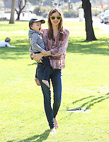 Miranda Kerr carries her adorable two-year-old son Flynn through Coldwater Canyon Park - Los Angeles