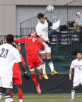 University of New Mexico forward Devon Sandoval (9) and University of Connecticut midfielder Colin Bradley (20) battle for head ball. .NCAA Tournament. With a goal in the second overtime, University of Connecticut (white) defeated University of New Mexico (red), 2-1, at Morrone Stadium at University of Connecticut on November 25, 2012.