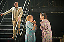 """London, UK. 16/09/2011. """"Street Scene"""" by Kurt Weill (music) and Elmer Rice (book) returns to The Young Vic, London. 24 hours in the life of a 1940's New York City tenement on a hot summer's day with an eighty-strong cast, full choir and orchestra. Joseph Shovelton (as Lippo Fiorentino), Simone Sauphanor (as Mrs Fiorentino) and Harriet Williams (as Mrs Olsen). Photo credit: Jane Hobson"""