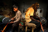 10 year old Shaifur working in a door lock factory in Old Dhaka. Unlike his colleague, Shaifur works without a mask. It is common in Bangladesh for children of poor parents to work in various hazardous and labour-intensive workplaces to support their families. 17.5 percent of all children aged between 5-15 are engaged in economic activities. The average child labourer earns between 400 to 700 taka (1 USD = 70 taka) per month, while an adult worker earns up to 5,000 taka per month..