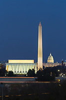 The Lincoln Memorial, Washington Monument, and US Capitol building illuminated during evening twilight in Washington, DC.