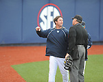North Carolina-Wilmington pitching coach Jason Howell (center) argues with home plate umpire Steve Dew (right) after being ejected after being ejected at Oxford-University Stadium in Oxford, Miss. on Saturday, February 25, 2012. Ole Miss won 6-4.