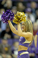 December 22, 2013:  Washington cheerleader Kayla Woods entertained fans during a timeout against Connecticut.  Connecticut defeated Washington 82-70 at Alaska Airlines Arena Seattle, Washington.