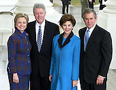 Washington, DC - January 20, 2001 -- United States President Bill Clinton and First Lady Senator Hillary Rodham Clinton (Democrat of New York) welcome President-elect George W. Bush and his wife Laura at the White House for a reception prior to the swearing-in ceremony at the United States Capitol..Credit: Ron Sachs / CNP