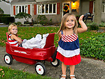 Sept. 11, 2012 - Merrick, New York, U.S. -  LYLA WILLIAMS, 3, and KATE OLLENDIKE, 2, helping place 500 Luminary Bags in front of 215 Wenshaw Park homes, on 11th Anniversary of 9/11, by Wenshaw Park Civic Association (WPCA), Long Island, with over $500 already raised for Twin Towers Orphan Fund.