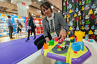 Mary Barney, one of the co-founders of the Tubby Table displays the bath toy at the 112th American International Toy Fair in the Jacob Javits Convention center in New York on Monday, February 16, 2015.  The new second generation Tubby Table keeps water off the floor but lets children enjoy their bath time with more activities for toddlers. The four day trade show with over 1000 exhibitors connects buyers and sellers and draws tens of thousands of attendees.  The toy industry generates over $84 billion worldwide and Toy Fair is the largest toy trade show in the Western Hemisphere. (© Richard B. Levine)