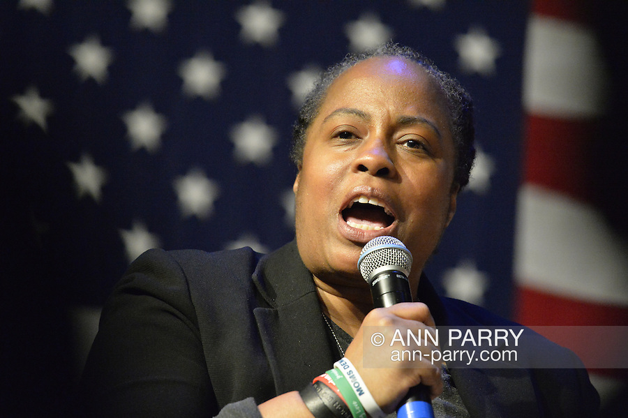Port Washington, New York, USA. April 11, 2016. MARIE DELUS who lost her nephew Pierre-Paul Jean-Paul in Queens, is panelist speaking on Hillary Clinton, Democratic presidential primary candidate, discussion on gun violence prevention with Rep. S Israel and activists who lost family members due to shootings. Clinton stressed tougher gun control legislation is needed and vowed to take on the gun lobby, NRA National Rifle Association.