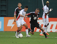 New England Revolution midfielder Benny Feilhaber (22) goes against D.C. United midfielder Perry Kitchen (23) D.C. United defeated The New England Revolution 3-2 at RFK Stadium, Saturday May 26, 2012.