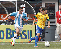 Brazil midfielder Oscar (10) dribbles as Argentina midfielder Jose Sosa (8) closes. In an international friendly (Clash of Titans), Argentina defeated Brazil, 4-3, at MetLife Stadium on June 9, 2012.