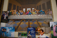 Family photos adorn a picture of the Last Supper.  Sanger, CA.